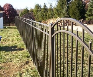 All gates produced by OnGuard are 'full width'; in other words, a 4 foot gate measures 48 inches so allowances have to be made for hardware (hinges and latch). Som other manufacturers sell a 4 foot gate that will fit in a 4 foot opening. Shown here is a four foot wide OnGuard Siskin style arched top gate.
