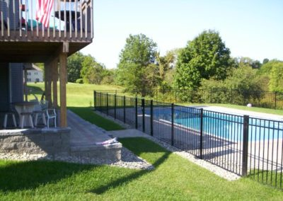 We stock OnGuard 54 inch BOCA pool code compliant aluminum fence in black Starling style (shown here). We also maintain a nice selection of matching gates in both straight and arched top. Starling panels can be fitted with rings, scrolls or butterflies for a different look than the neighbors pool fence.