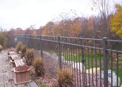 Bronze Siskin pool fence meets the BOCA pool code. Siskin is available in all heights and your choice of any OnGuard color. The pressed point pickets between the mid and top rails can be modified and finials added.
