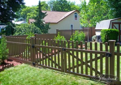 Illusions V350-4TR contemporary spaced picket fence with dog ear cap in Brown L106. Grand Illusions offers single leaf gates up to 6 feet wide.