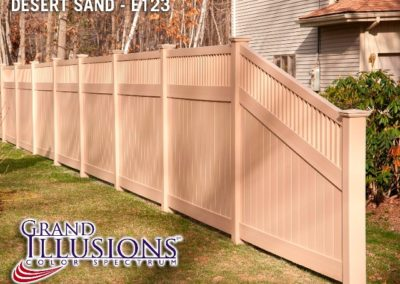 Grand Illusions style V3701 - Tongue and Groove privacy panels with a framed Victorian picket top in E123 Desert Sand. The sloped section on the end is called a 'Transition' panel and the top rail is available in a variety of shapes.