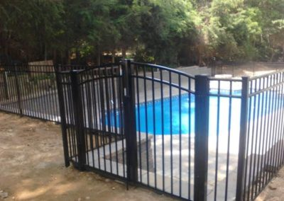 A pool code compliant continuous dome arched top double gate in the OnGuard Starling style shown here in black. A realy nice gate that's practical as well if your installation will have only one entry. You should consider access to the enclosure for things such as wheel barrows and lawn mowers when choosing a gate width.