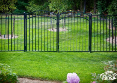 Two Eastern Aluminum Fence Style EO54200 Accent gates set as a double drive. Note the drop rod on the 'stationary' leaf of the gate.