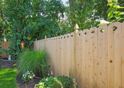 This beautiful Eastern White Cedar fence has a style nine board ( can be done in 1x6 as an up charge - standard boards are 1x4) and is installed on 4x4 treated posts with a Gothic cut top. NOTE: panels that use 2 boards for the shaped top (styles 1,6, 8, 14, 15 and 16) do nt rack well since the boards wil move in relation to one-another. A step installation works much better for these panels.