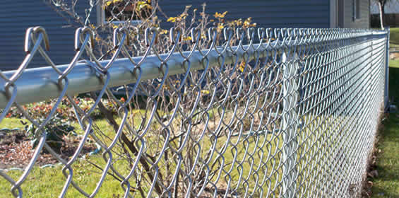 A common misconception is that galvanized chain link mesh (fabric) is less expensive than vinyl coated. It is not because the galvanized product is 9 gauge METAL wheras the vinyl coated is most often an 11.5 gauge aluminized core and the vinyl adds the difference and brings it up to 9 gauge thickness.
