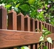 Grand Illusions WoodBond Rosewood wood grain finish vinyl fence