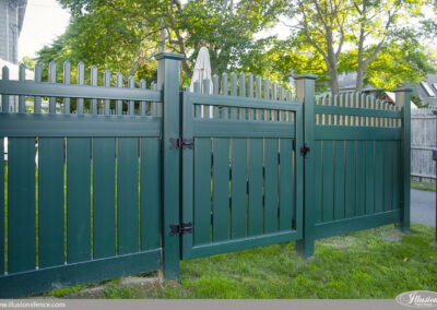 Illusions V5708 semi privacy vinyl fence panels with a crowned Victorian picket top in Grand Illusions Eastern Green