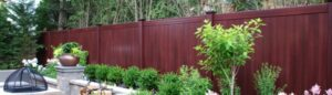 Grand Illusions Mahogany wood grain vinyl fence