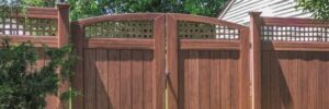 Grand Illusions vinyl fence gates are available in wood grain