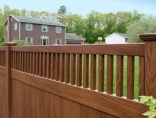 V3701 T&G privacy panel with framed Classic Victorian picket top finished in Grand Illusions Rosewood wood grain vinyl.
