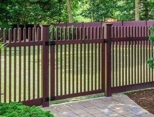 V700 Classic Victorian picket fence in Mahogany wood grain vinyl finish.