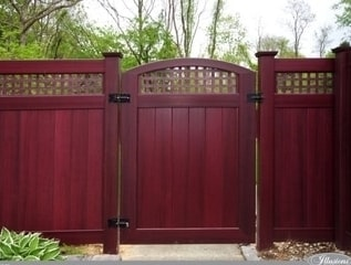 V3215SQ - A T&G privacy panel with square lattice top and a matching crowned gate all in Mahogany wood grain vinyl.
