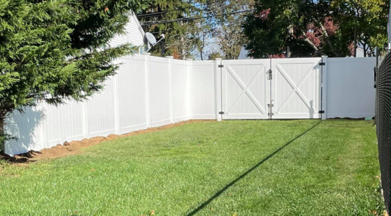 Illusions fence style V300-6 with matching double drive gate shown from inside.